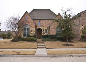 Beautiful home on corner lot in Star Creek with stone exterior.
