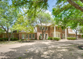 Beautiful custom home on double acre treed lot in River Oaks.