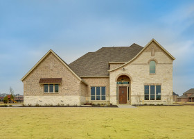 Beautiful custom built home in Lovejoy ISD with extensive stone exterior.